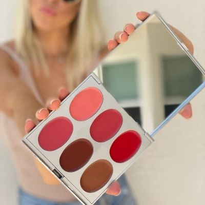 Woman holding lip palette